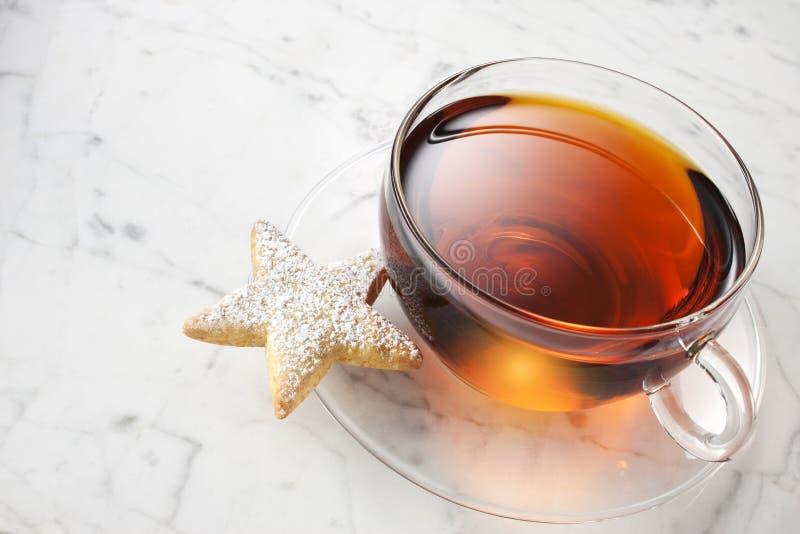 Taza de té de la galleta fotografía de archivo libre de regalías