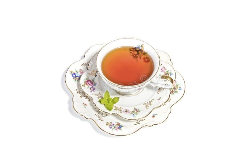 Taza de té en el alto té fotografía de archivo
