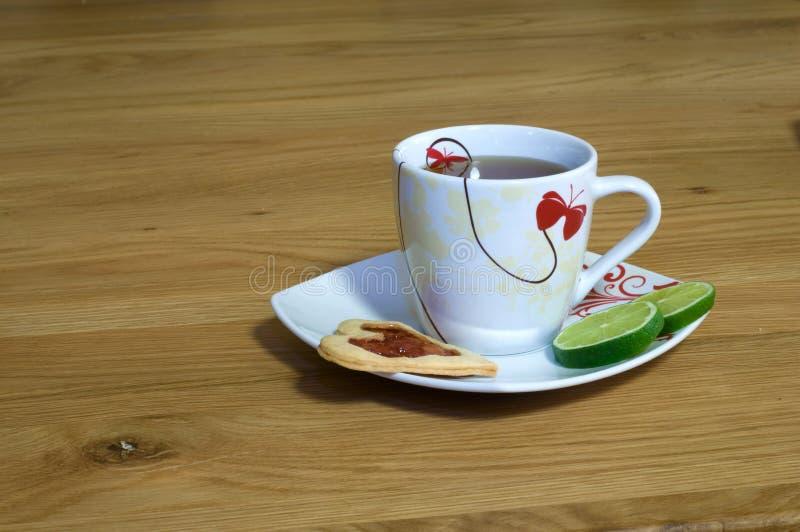 Taza de té en el vector foto de archivo