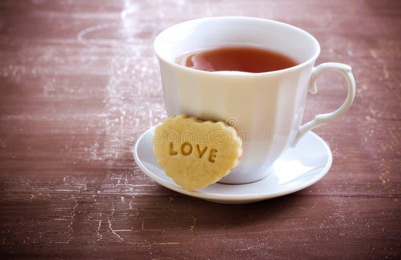 Taza de té y de galleta fotografía de archivo