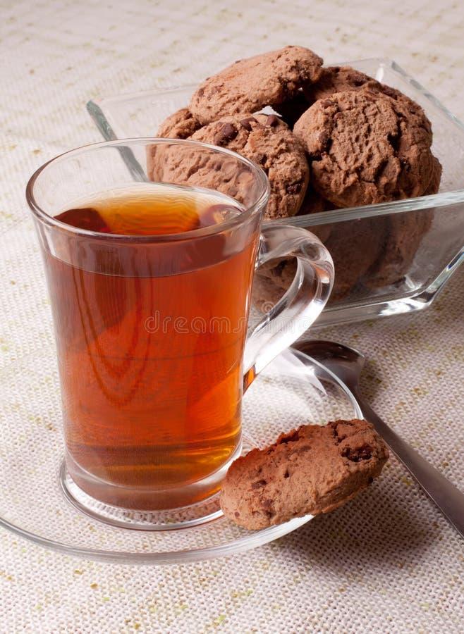 Taza de té y de galletas imagen de archivo libre de regalías