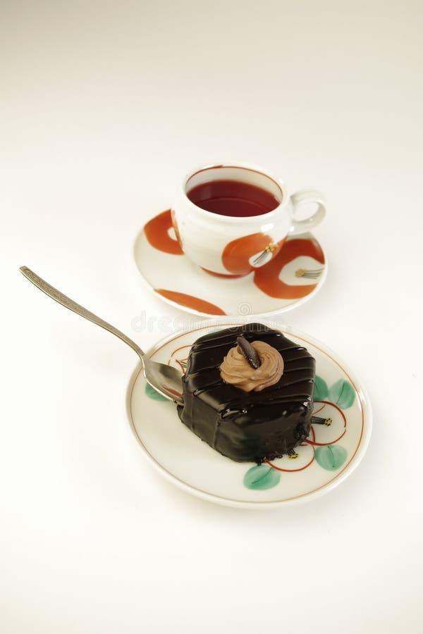 Taza de té y pedazo de torta imagenes de archivo