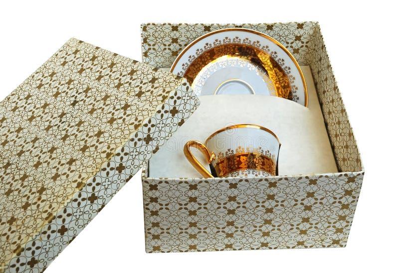 Taza del oro imagen de archivo libre de regalías