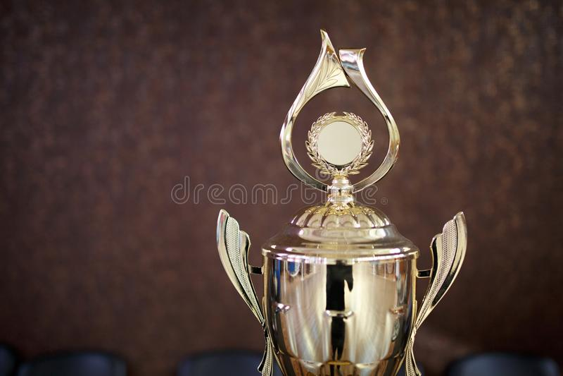 Taza del oro para el ganador 1ra recompensa del lugar fotos de archivo libres de regalías