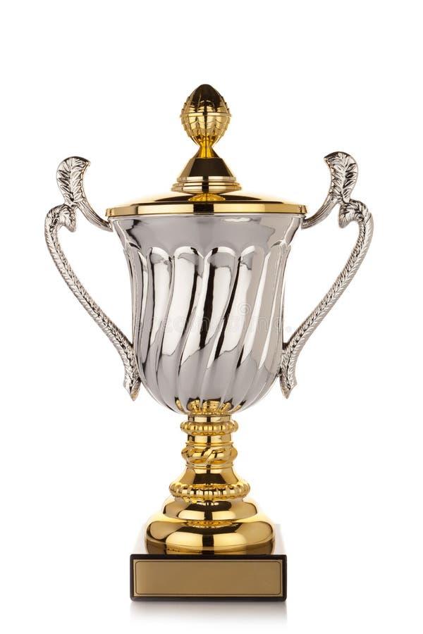 Taza del trofeo del oro en el fondo blanco fotos de archivo libres de regalías