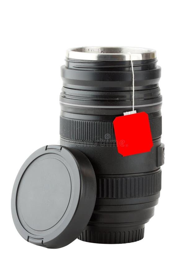 Taza hecha de la lente fotográfica profesional foto de archivo libre de regalías