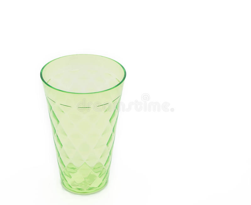 Taza plástica verde foto de archivo