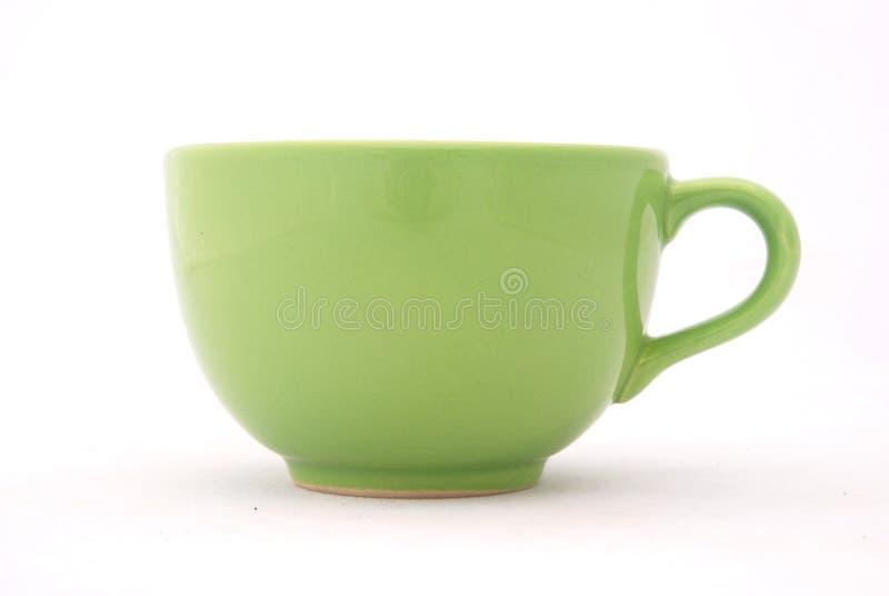 Taza verde foto de archivo