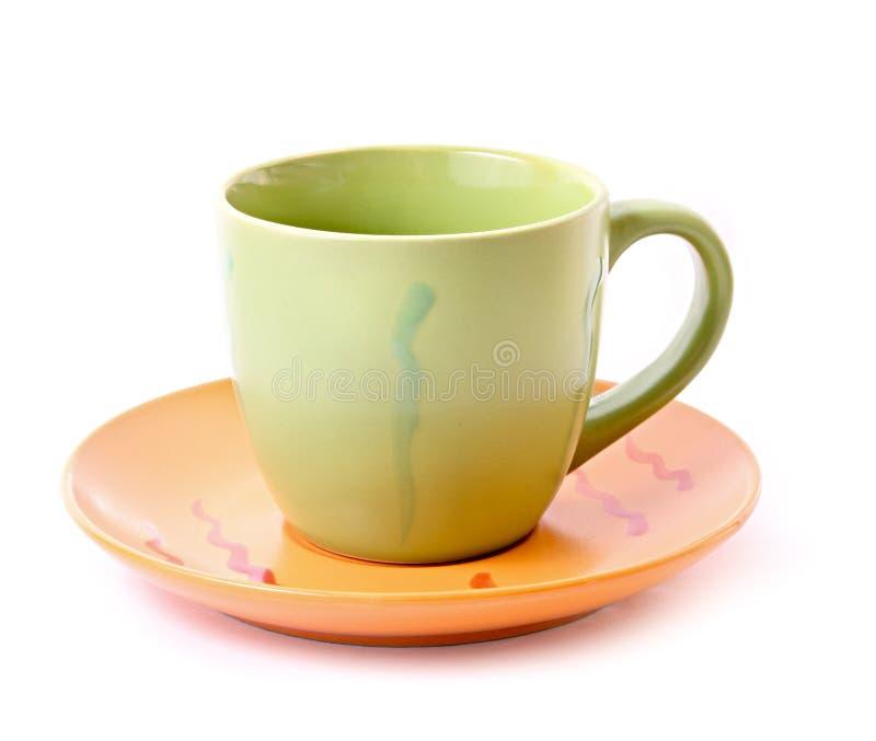 Taza verde con el platillo aislado imagen de archivo libre de regalías