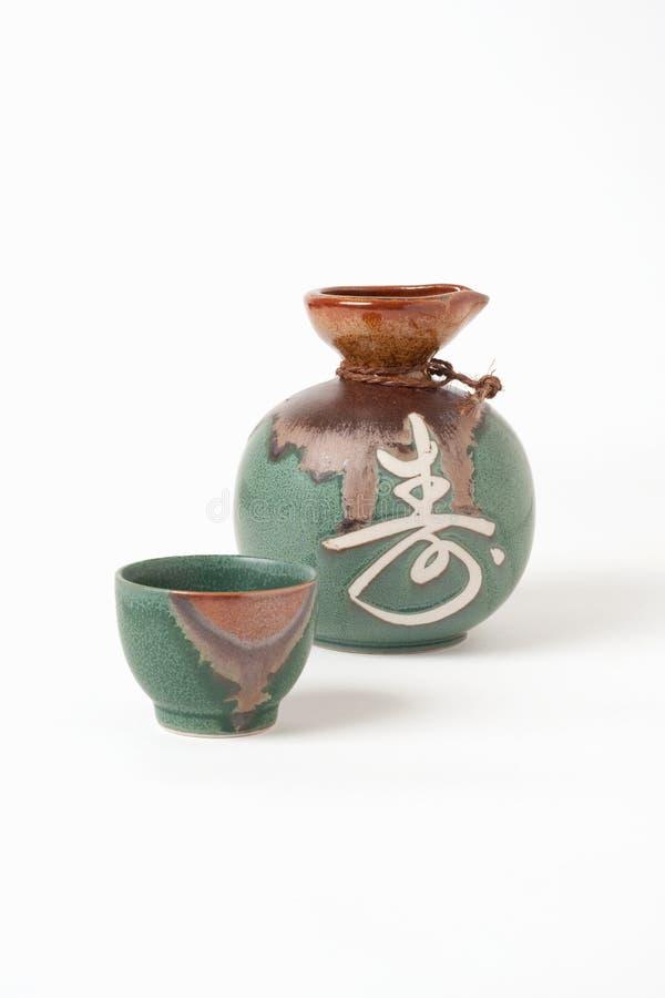 Taza y jarra de motivo foto de archivo