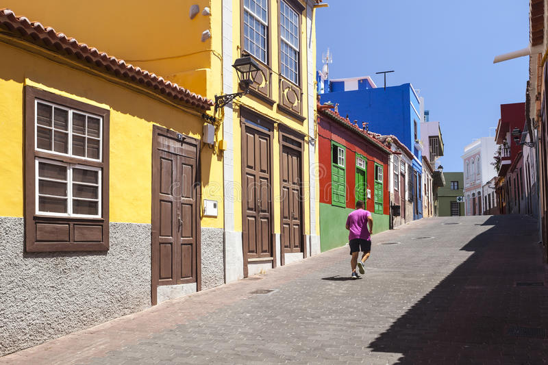 Tazacorte, La Palma, Canary Islands. Runner in a pink shirt in a colorful street in Tazacorte, La Palma, Canary Islands stock photography