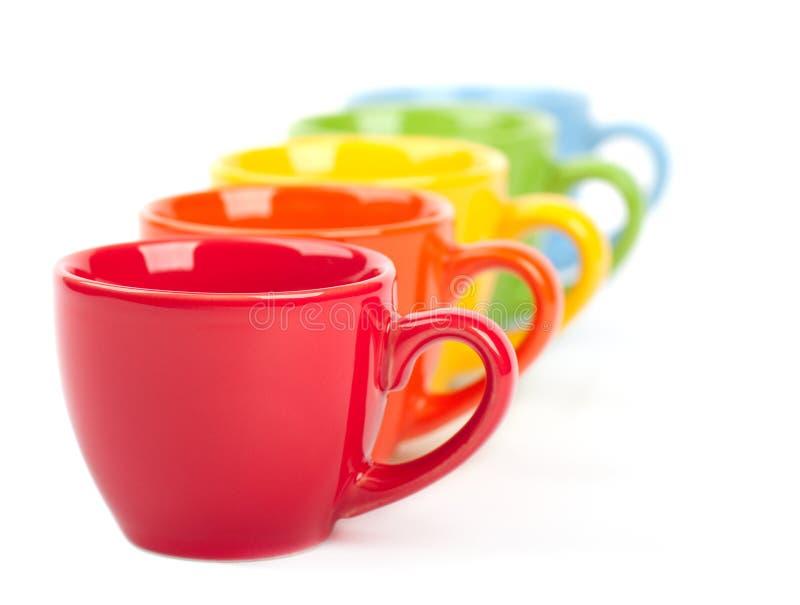 Tazas coloridas fotografía de archivo libre de regalías