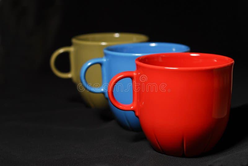 Tazas de café coloridas imágenes de archivo libres de regalías