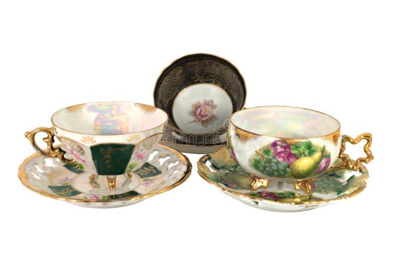 Tazas de té footed aisladas de la vendimia tres fotografía de archivo libre de regalías