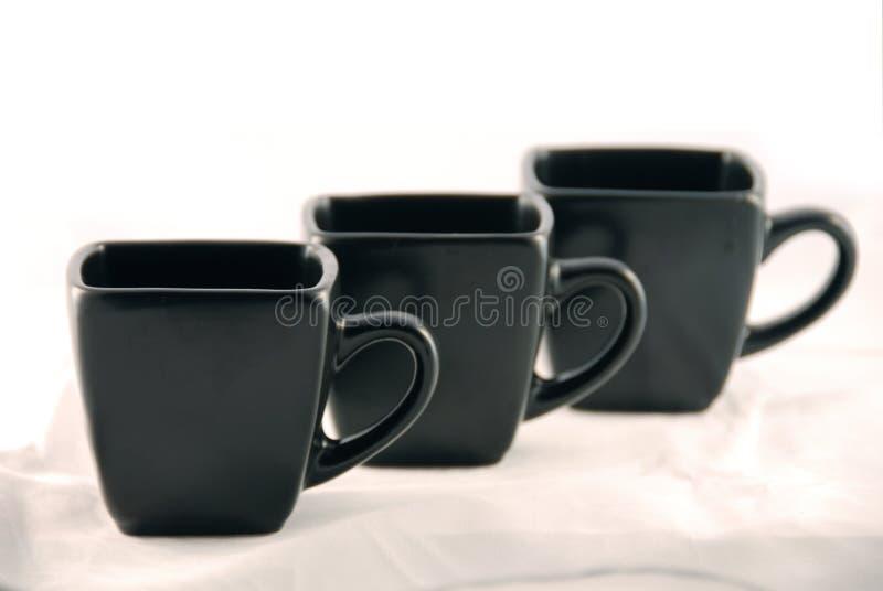 Tazas negras fotografía de archivo libre de regalías