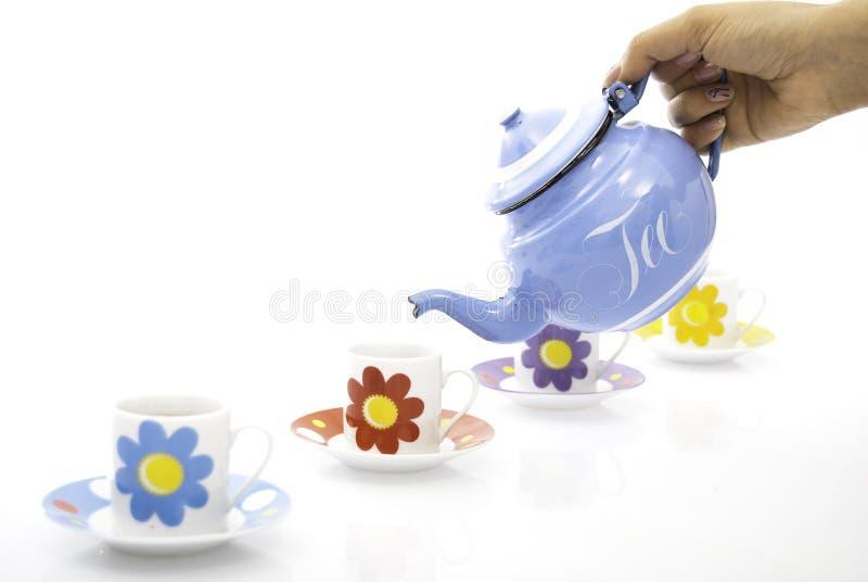 Tazas y caldera de té foto de archivo
