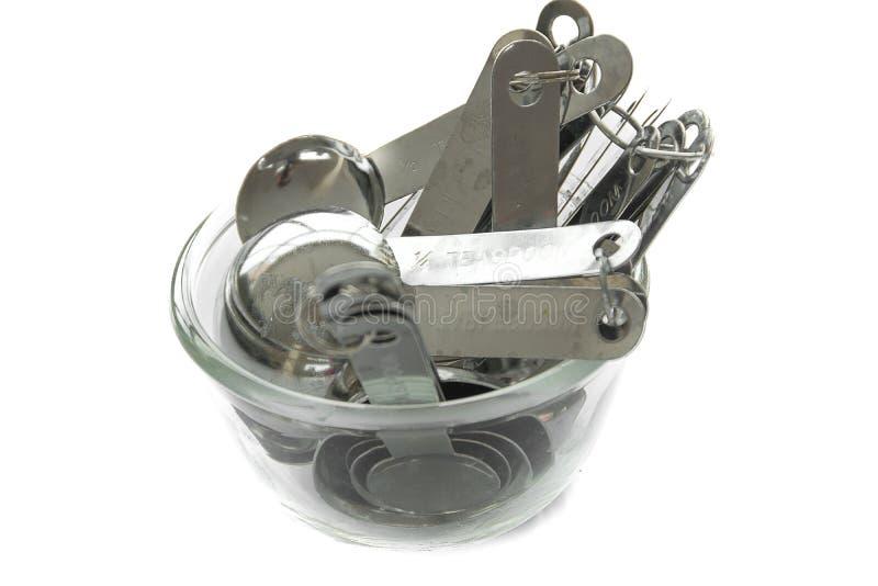 Tazas y cucharas de medición imagen de archivo libre de regalías