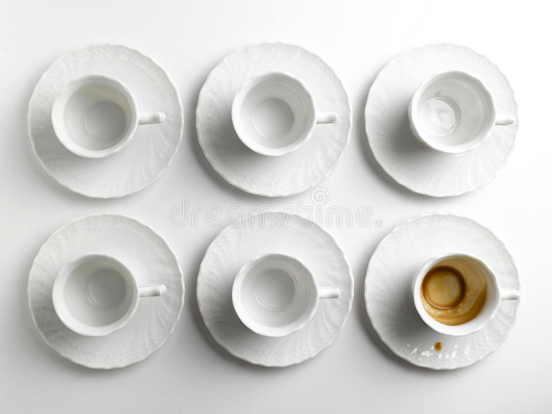 Tazas y platillos de café imagen de archivo libre de regalías