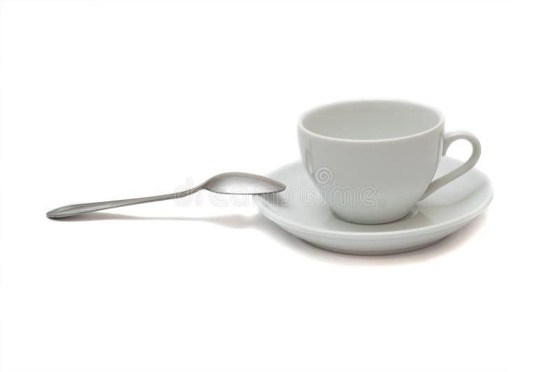 Tazza bianca con il cucchiaio ed il piattino immagini stock