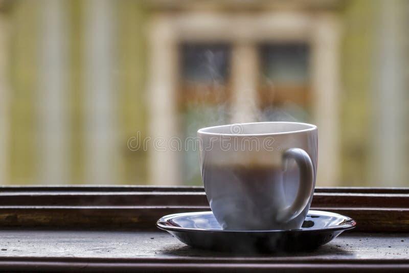 Tazza calda di coffe con vapore immagine stock libera da diritti