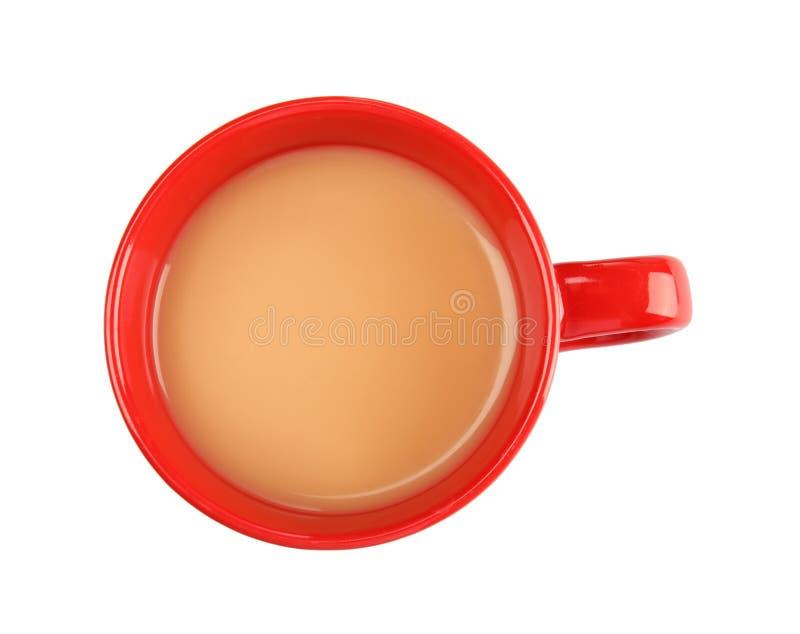 Tazza con tè nero e latte fotografia stock libera da diritti
