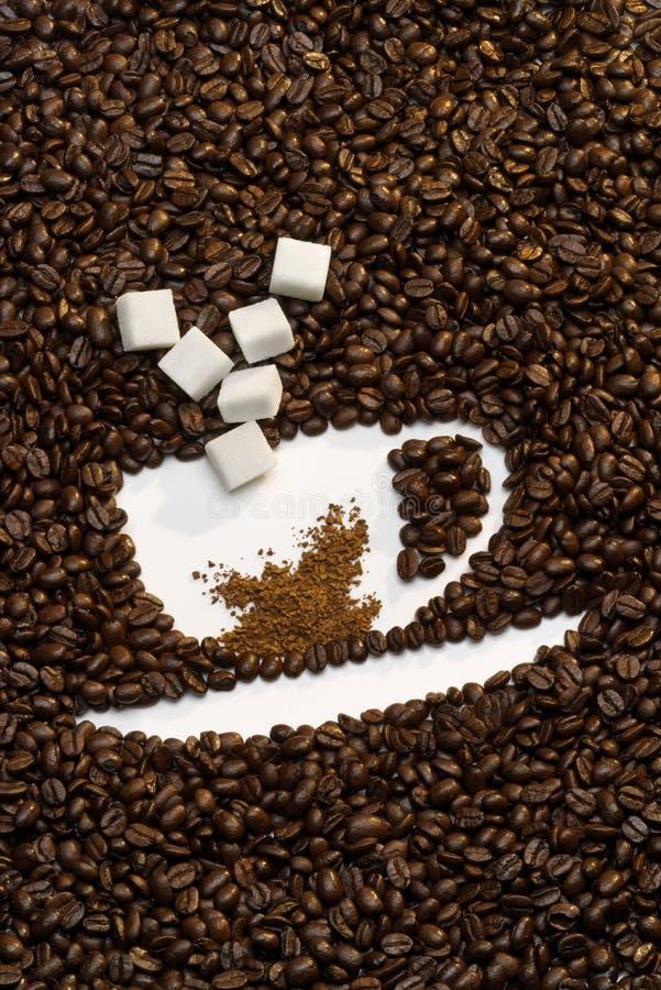 Tazza del chicco di caffè fotografie stock libere da diritti