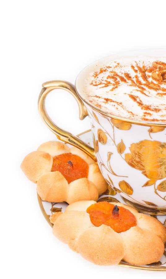 Tazza del cuppuccino con i biscotti fotografia stock