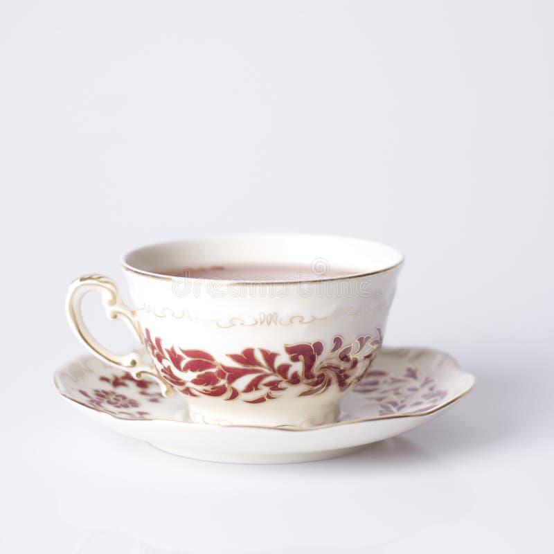 Tazza dell'annata di tè immagini stock