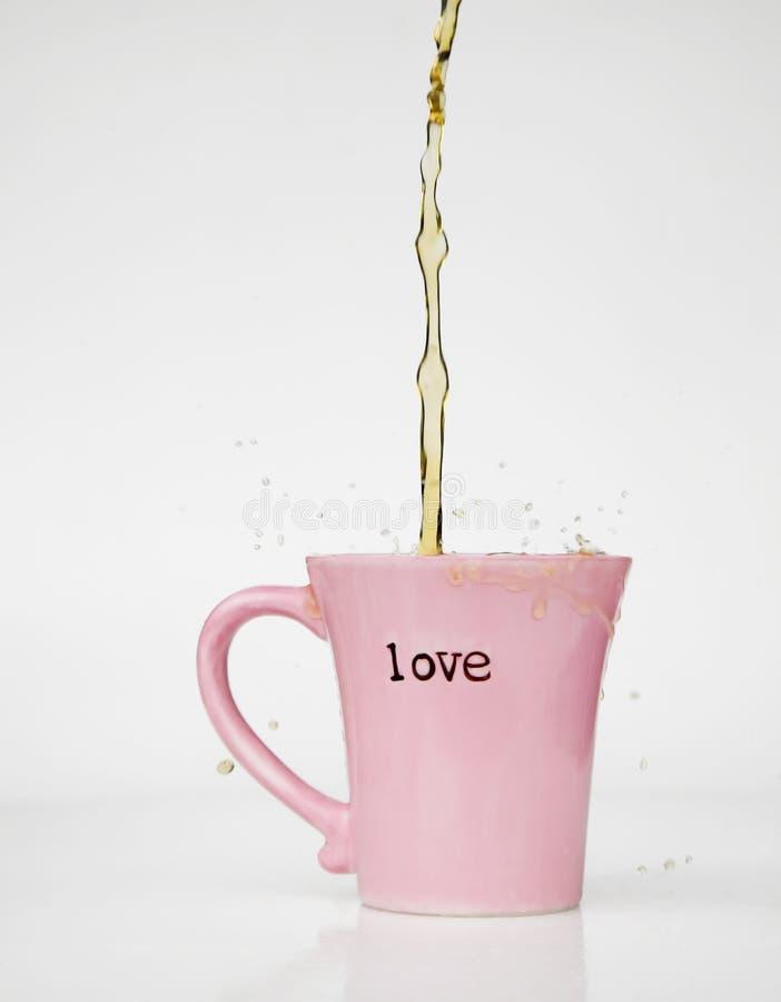 Tazza di amore della spruzzata del caffè immagine stock libera da diritti