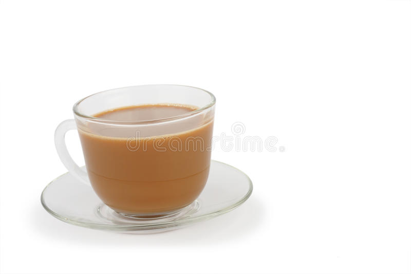 Tazza di caffè con crema ed il piattino immagini stock libere da diritti