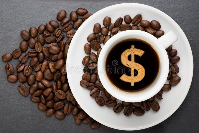 Tazza di caffè con il dollaro fotografia stock