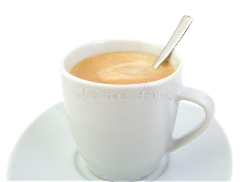 Tazza di caffè con un cucchiaio immagine stock