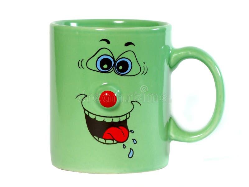 Tazza di caffè con un grin fotografia stock