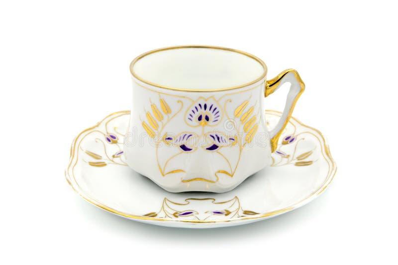 Tazza di caffè dell'oggetto d'antiquariato di tempo di Art Nouveau su fondo bianco fotografie stock libere da diritti