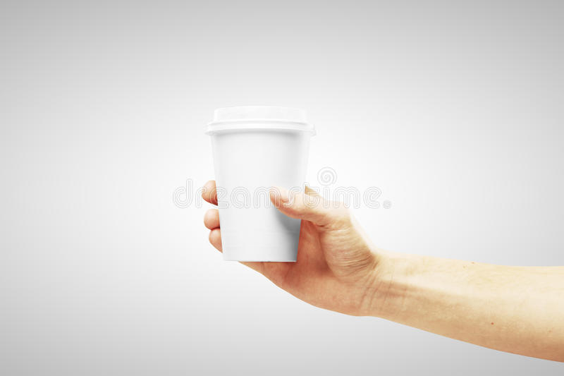 Tazza di caffè a disposizione fotografie stock