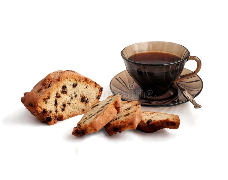 Tazza di caffè e torta con l'uva passa. immagini stock libere da diritti