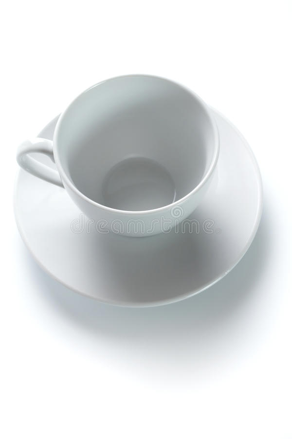 Tazza di caffè e un piattino immagini stock