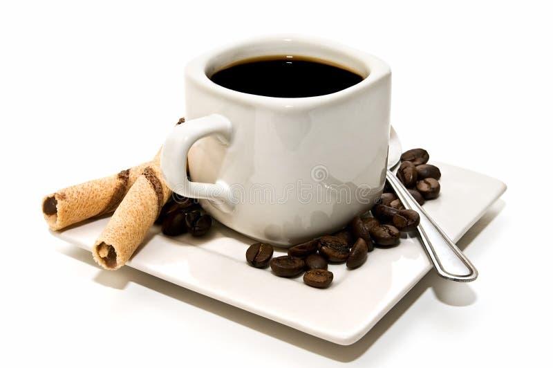 Tazza di caffè isolata con la decorazione immagine stock