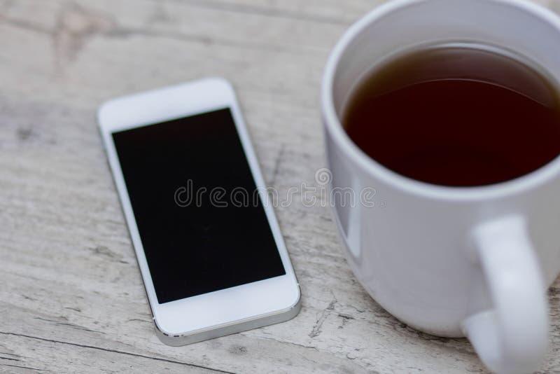 Tazza di caffè, Smart Phone e compressa fotografia stock