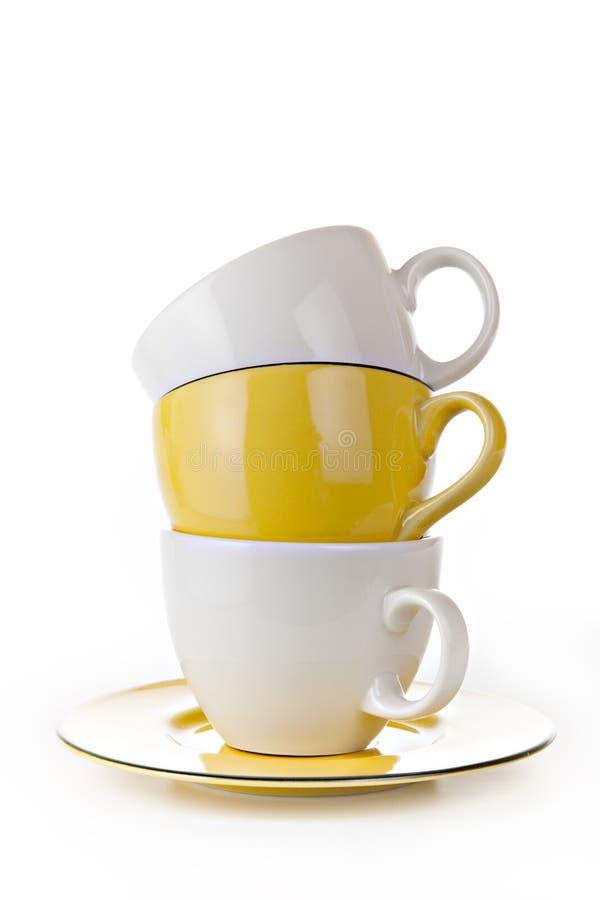 Tazza di Coffe isolata su priorità bassa bianca fotografie stock