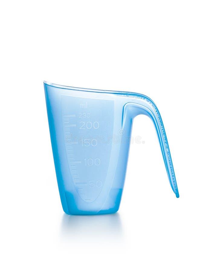 Tazza di misurazione detergente fotografie stock