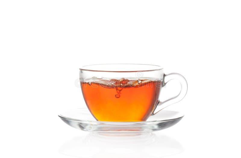 Tazza di tè nero caldo con le bolle di aria immagini stock libere da diritti