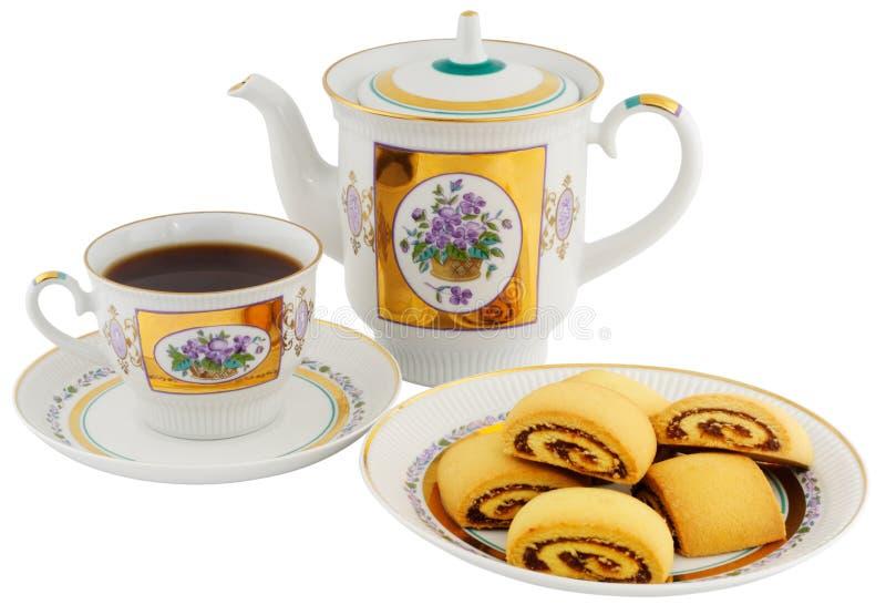Tazza di tè, teiera e biscotti immagine stock