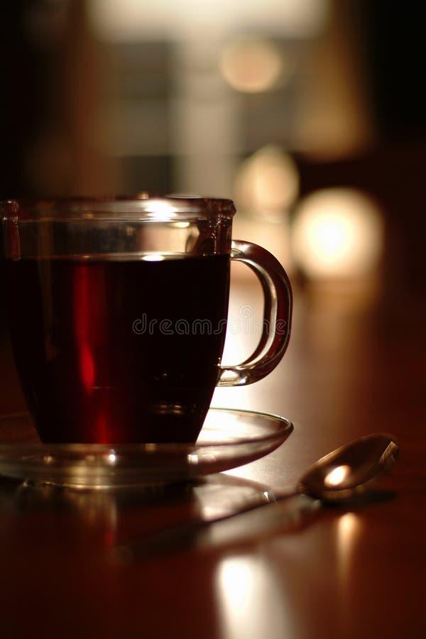 Download Tazza e cucchiaio di caffè fotografia stock. Immagine di fagiolo - 204788