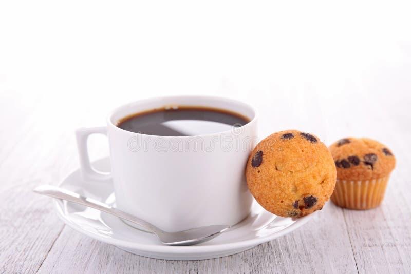 Tazza e muffin di caffè immagine stock