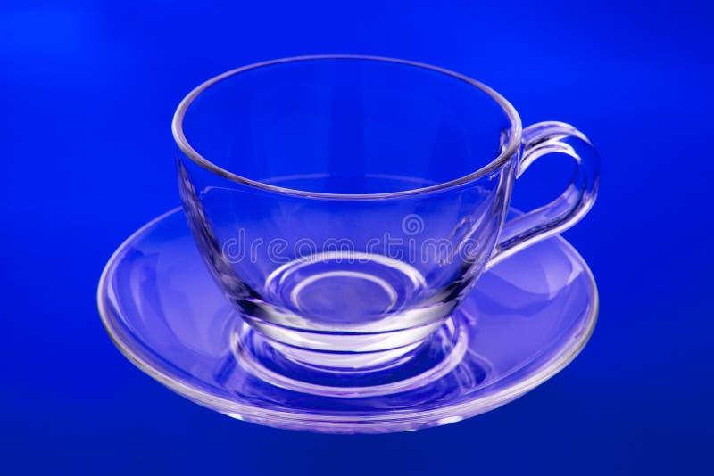 Tazza e piattino di vetro vuoti fotografia stock libera da diritti