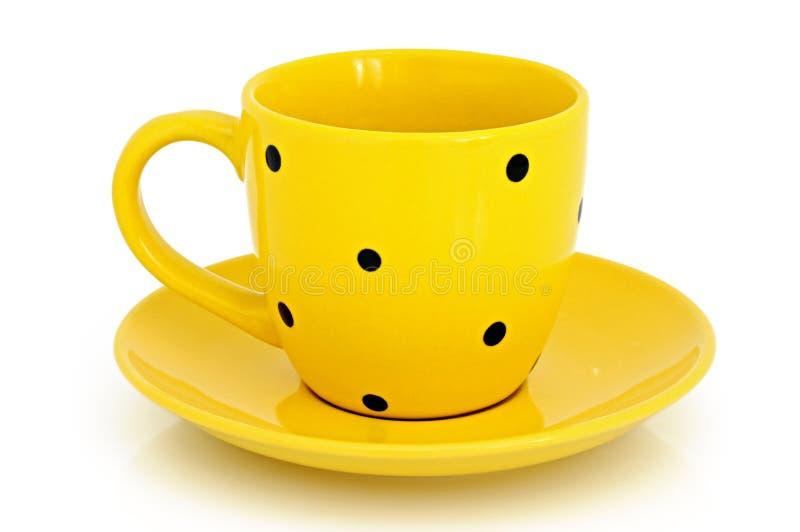 Tazza e piattino gialli fotografia stock libera da diritti