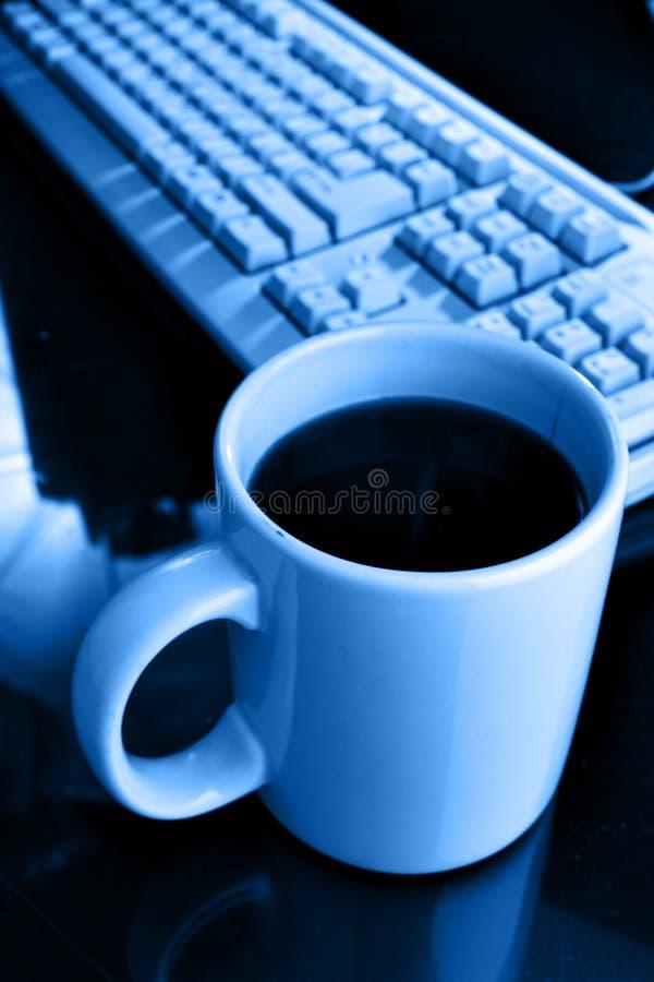 Tazza e tastiera di caffè immagini stock