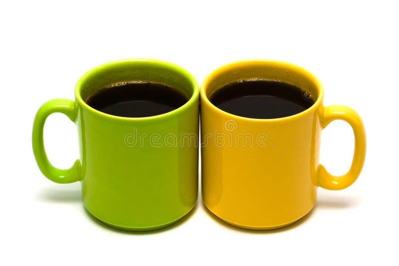 Tazza gialla e verde da caffè fotografia stock libera da diritti