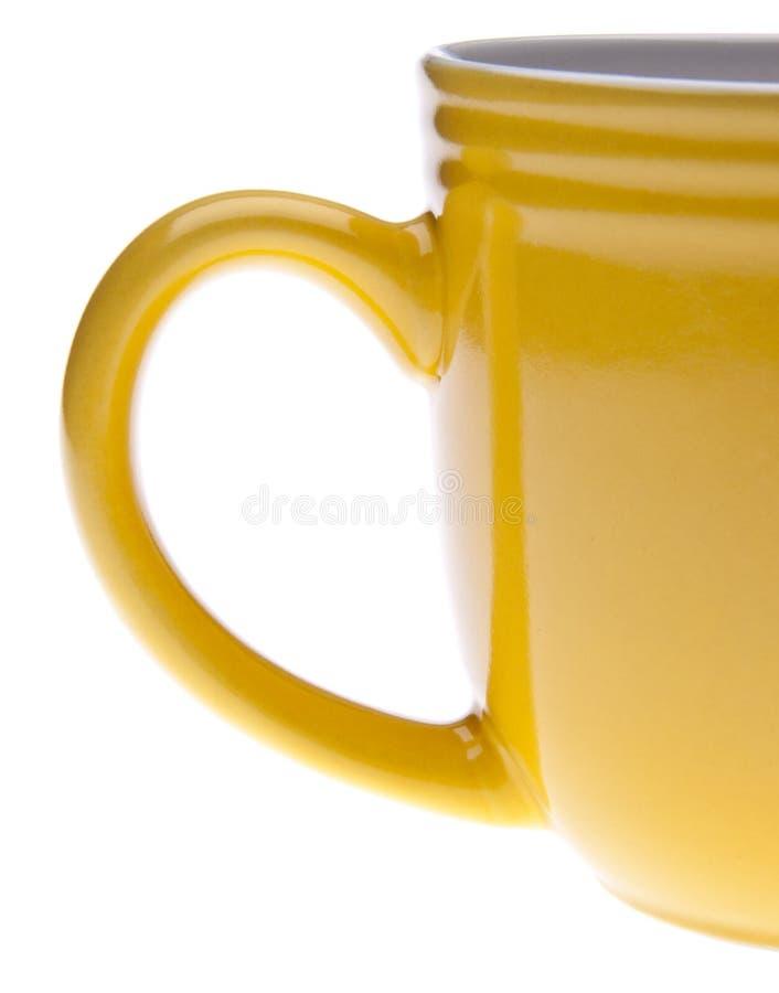 Tazza gialla vibrante immagini stock libere da diritti